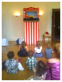 children watching a punch and judy show